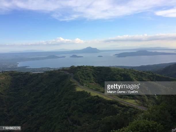 scenic view of landscape against sky - domo stock pictures, royalty-free photos & images