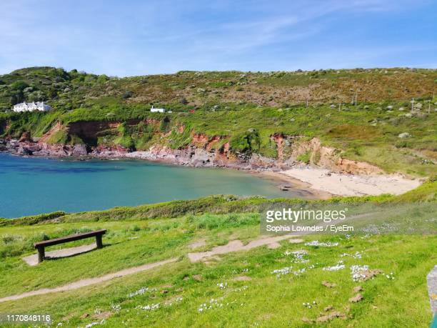 scenic view of landscape against sky - beach stock pictures, royalty-free photos & images