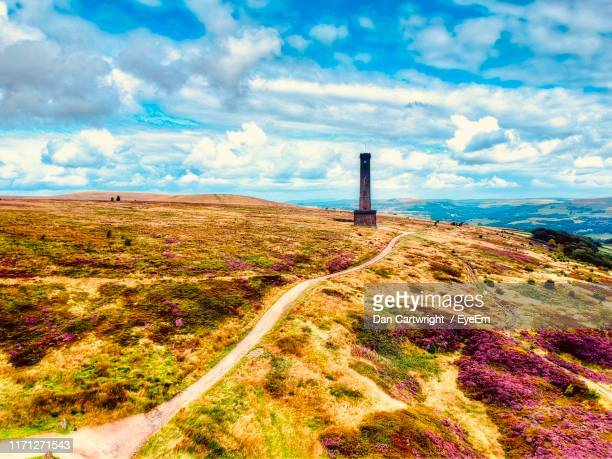 scenic view of landscape against sky - tower stock pictures, royalty-free photos & images