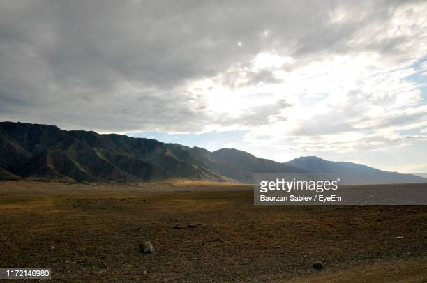 scenic view of landscape against sky - kazakhstan stock pictures, royalty-free photos & images