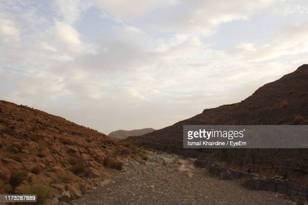 scenic view of landscape against sky - ismail khairdine stock photos and pictures