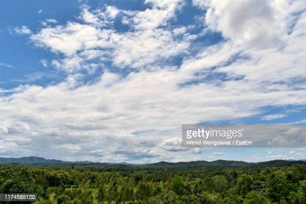scenic view of landscape against sky - wimol wongsawat stock photos and pictures
