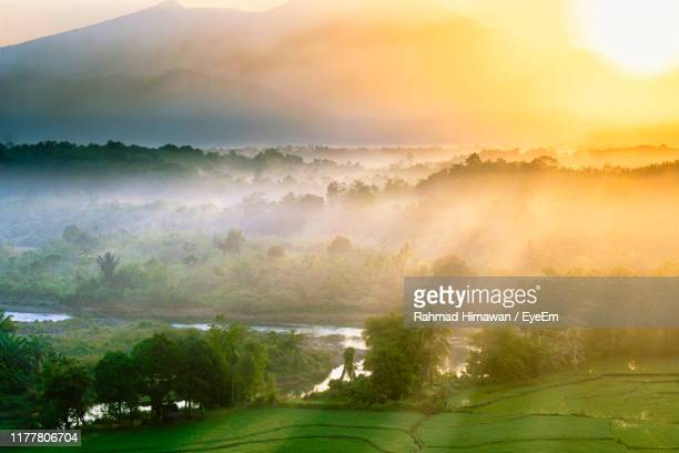 scenic view of landscape against sky - rahmad himawan stock photos and pictures