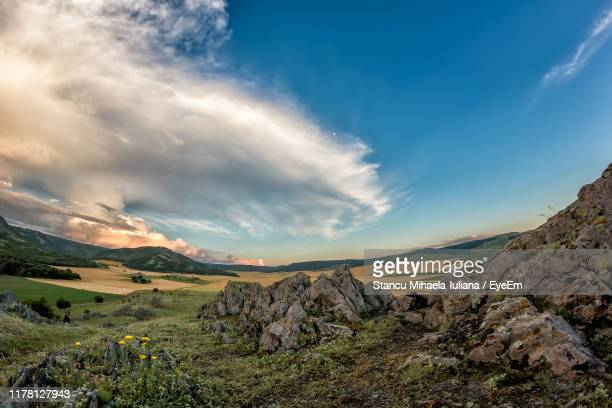 scenic view of landscape against sky - moldova stock pictures, royalty-free photos & images