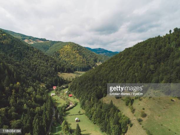 scenic view of landscape against sky - bortes stock photos and pictures