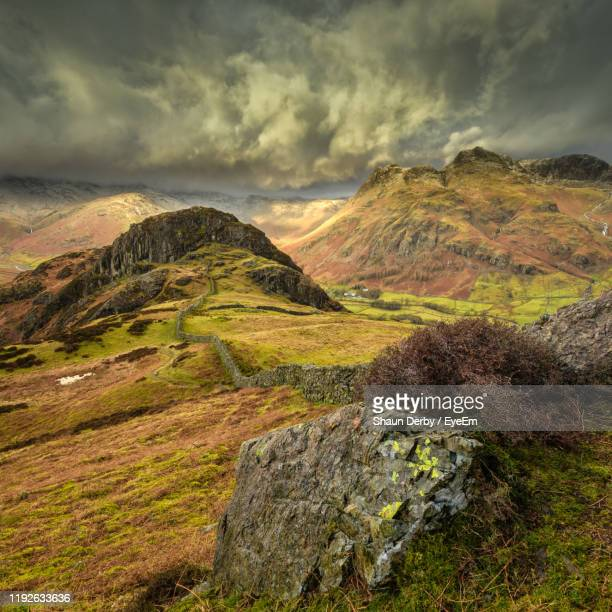scenic view of landscape against sky - english lake district stock pictures, royalty-free photos & images