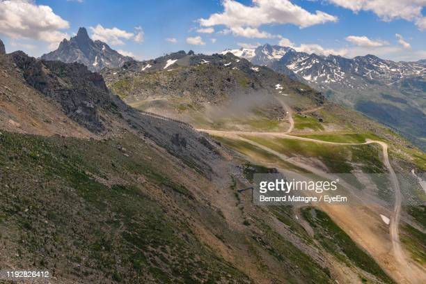 scenic view of landscape against sky - trois vallees stock pictures, royalty-free photos & images