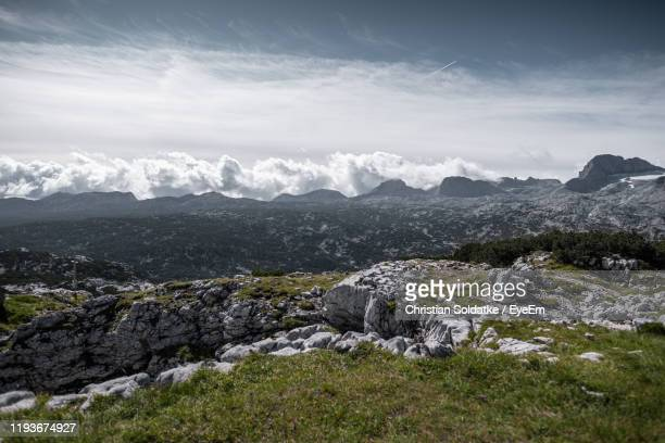 scenic view of landscape against sky - christian soldatke stock pictures, royalty-free photos & images