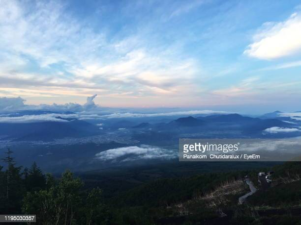 scenic view of landscape against sky - panaikorn chutidaralux stock photos and pictures