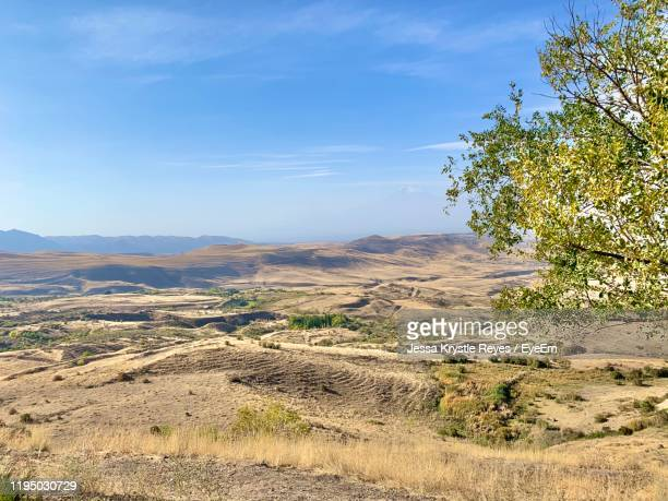 scenic view of landscape against sky - jessa stock pictures, royalty-free photos & images