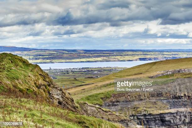 scenic view of landscape against sky - boris stock pictures, royalty-free photos & images