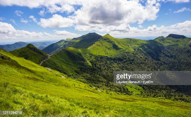 scenic view of landscape against sky - cantal stock pictures, royalty-free photos & images