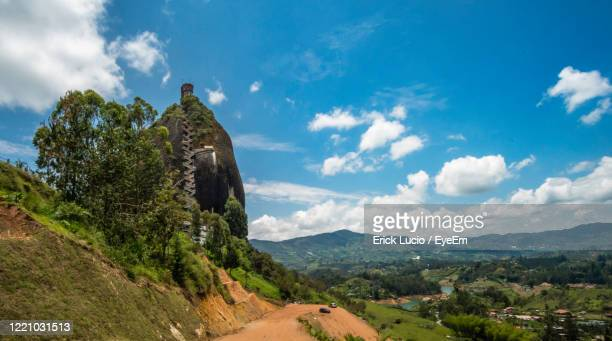 scenic view of landscape against sky - guatapé stock pictures, royalty-free photos & images
