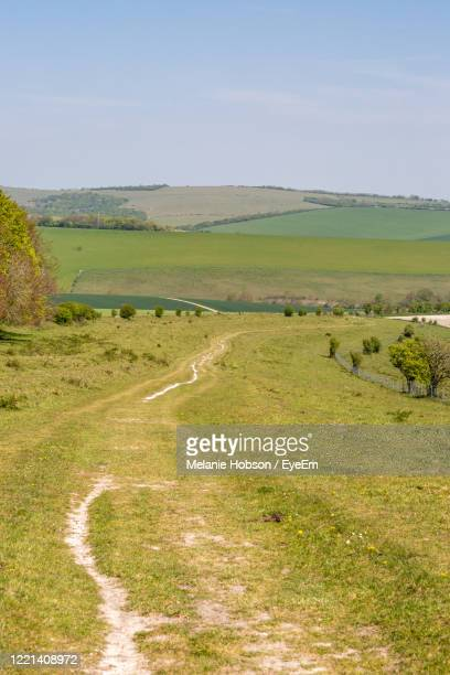 scenic view of landscape against sky - national park stock pictures, royalty-free photos & images