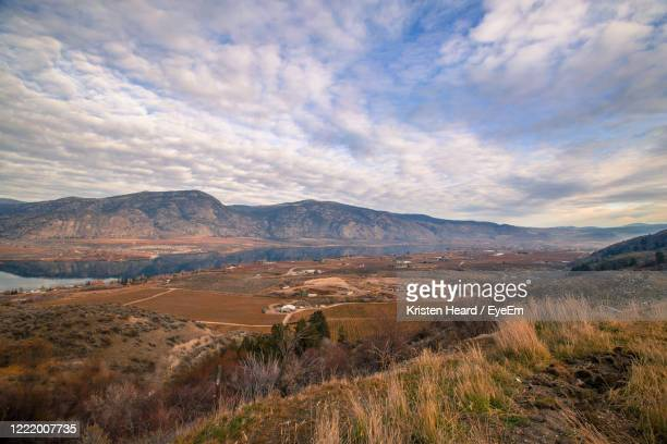 scenic view of landscape against sky - thompson okanagan region british columbia stock pictures, royalty-free photos & images