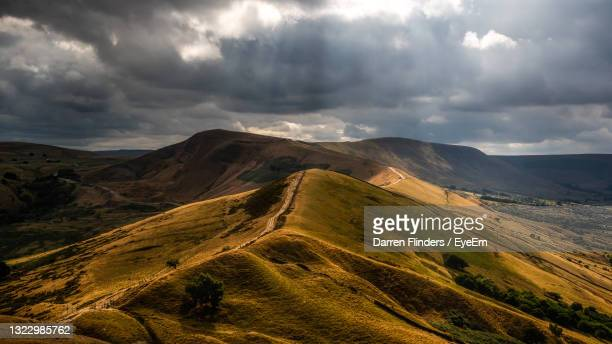 scenic view of landscape against sky - sunbeam stock pictures, royalty-free photos & images