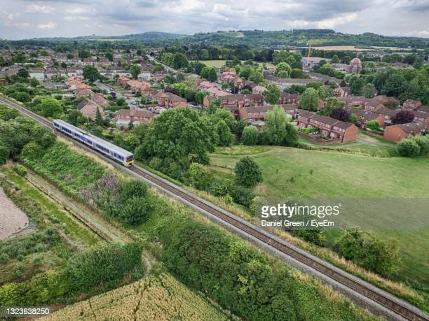 scenic view of landscape against sky - rail transportation stock pictures, royalty-free photos & images