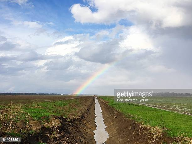 scenic view of landscape against sky - ditch stock photos and pictures
