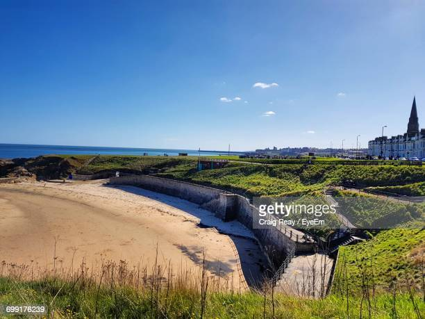 scenic view of landscape against sky - whitley bay stock pictures, royalty-free photos & images