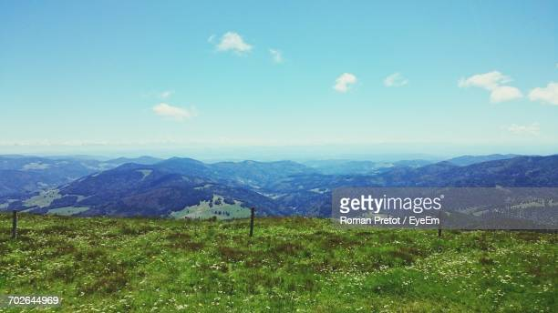 scenic view of landscape against sky - roman pretot stock-fotos und bilder