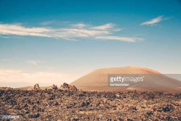 scenic view of landscape against sky - bortes stockfoto's en -beelden