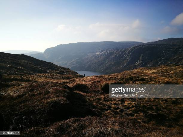 scenic view of landscape against sky - meghan stock photos and pictures