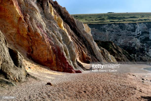 scenic view of landscape against sky - alum bay stock pictures, royalty-free photos & images