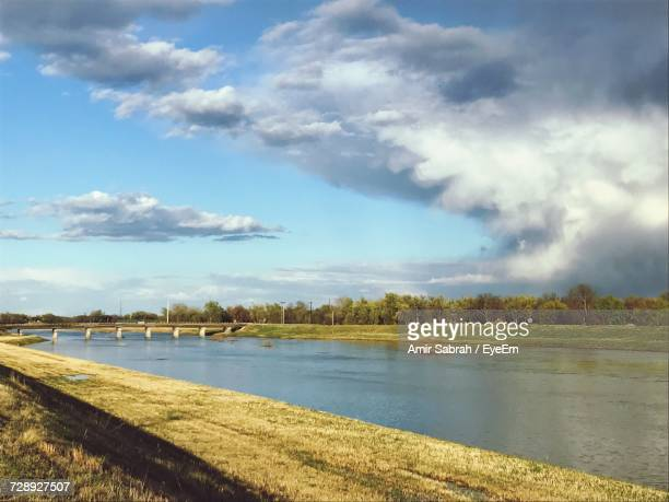 scenic view of landscape against sky - wichita stock photos and pictures