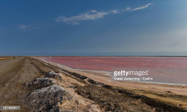 scenic view of landscape against sky - walvis bay stock photos and pictures