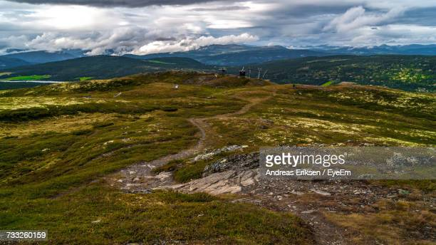 scenic view of landscape against sky - eriksen foto e immagini stock