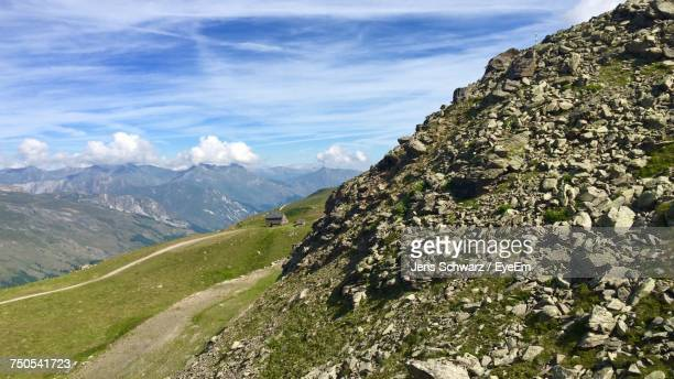 scenic view of landscape against sky - auvergne rhône alpes stock photos and pictures