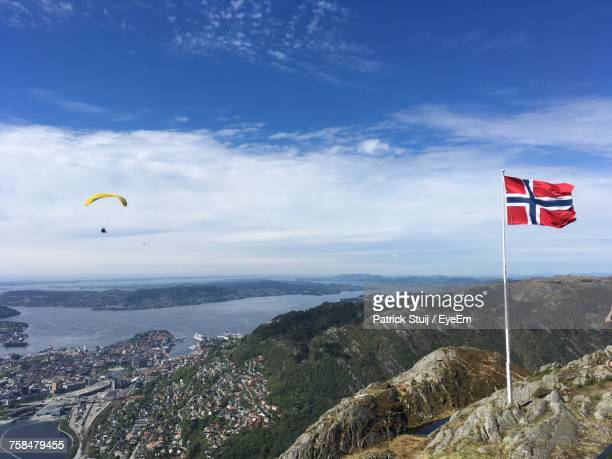 scenic view of landscape against sky - norwegian flag stock pictures, royalty-free photos & images