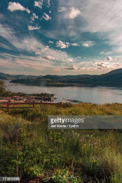 scenic view of landscape against sky - kelowna stock pictures, royalty-free photos & images