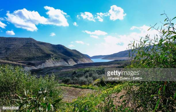 scenic view of landscape against sky - cuomo stock pictures, royalty-free photos & images