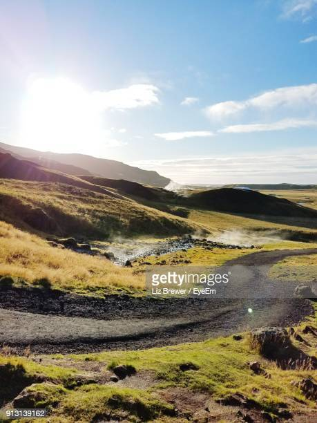 scenic view of landscape against sky - liz brewer stock photos and pictures