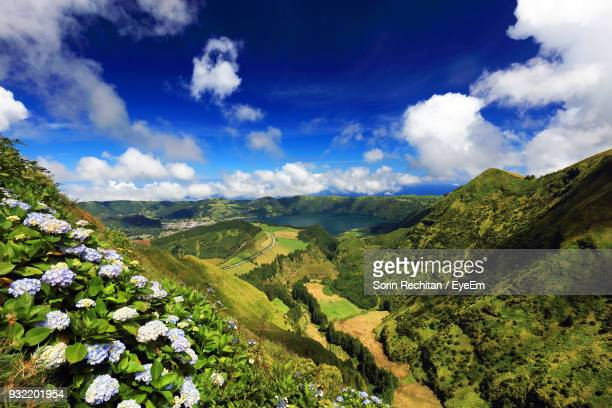 scenic view of landscape against sky - ponta delgada stock photos and pictures