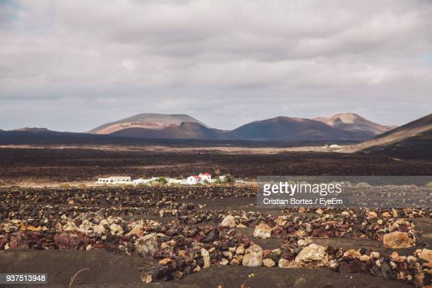 scenic view of landscape against sky - bortes photos et images de collection