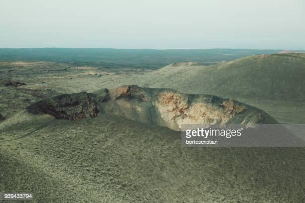 scenic view of landscape against sky - bortes fotografías e imágenes de stock
