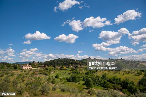 scenic view of landscape against sky - marek stefunko stock photos and pictures