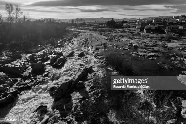 scenic view of landscape against sky,puente del congosto,spain - blanco y negro stock-fotos und bilder