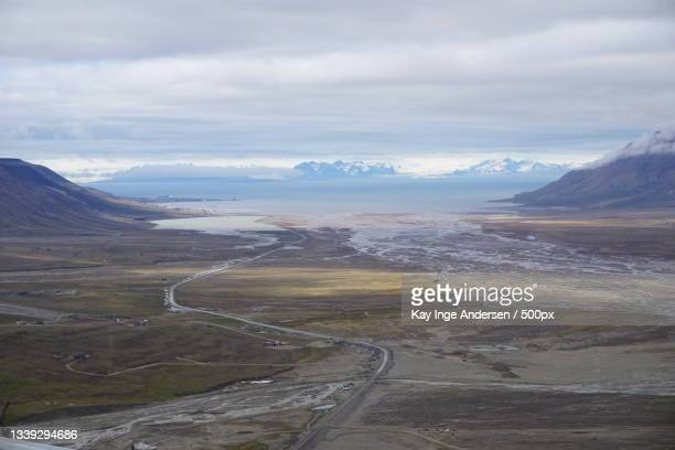 scenic view of landscape against sky,svalbard,norway - svalbard and jan mayen stock pictures, royalty-free photos & images