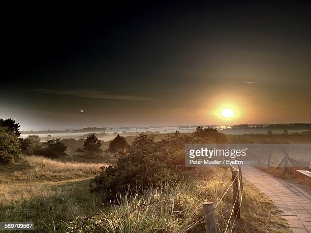scenic view of landscape against sunset sky - middelburg netherlands stock pictures, royalty-free photos & images