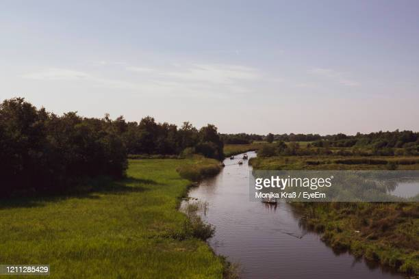 scenic view of landscape an small river against sky - overijssel stock pictures, royalty-free photos & images