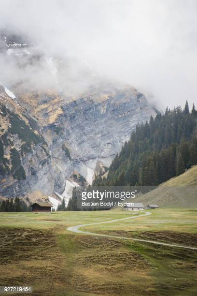 Scenic View Of Landscape And Mountain Against Cloudy Sky