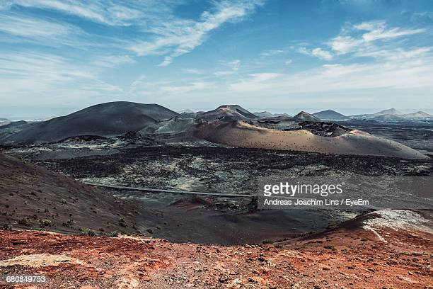 scenic view of landscape and mountain against sky - timanfaya national park stock pictures, royalty-free photos & images