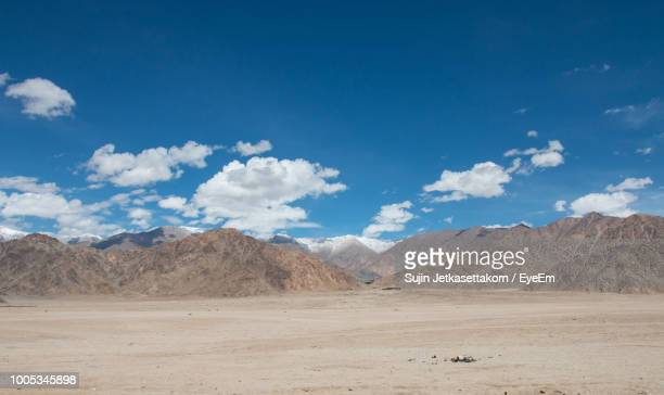 scenic view of landscape and mountains against blue sky - madhya pradesh stock pictures, royalty-free photos & images