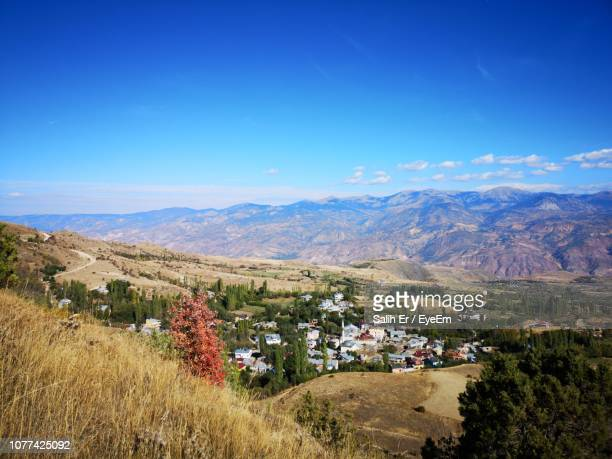 scenic view of landscape and mountains against blue sky - sivas stock pictures, royalty-free photos & images