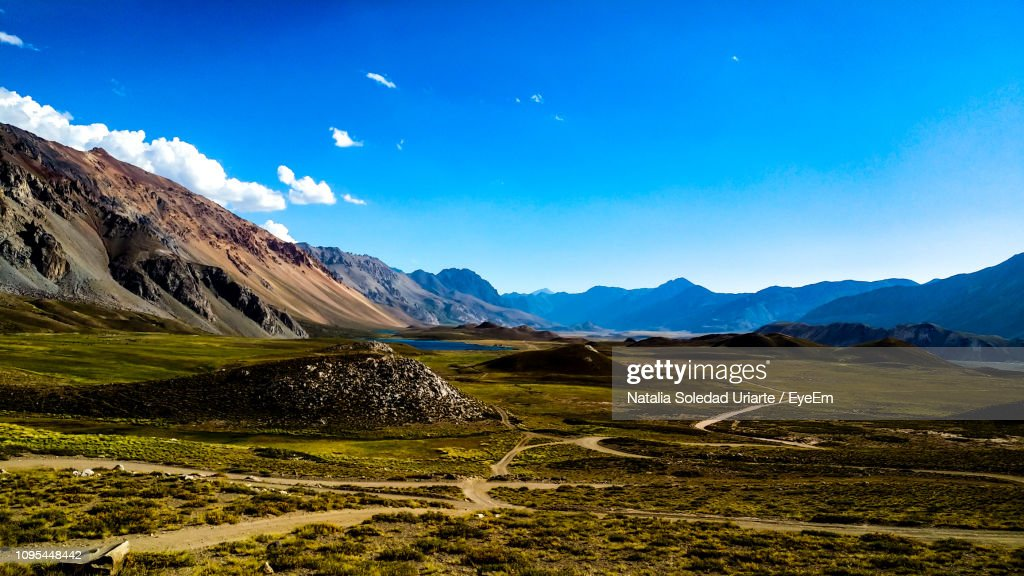 Scenic View Of Landscape And Mountains Against Blue Sky : Stock-Foto