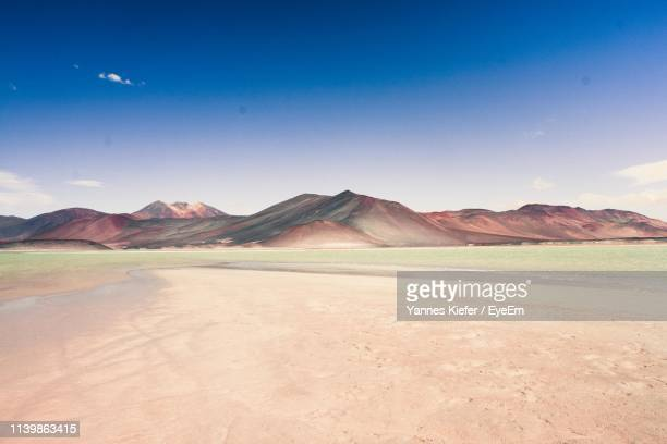 scenic view of landscape and mountains against blue sky - salt flat stock pictures, royalty-free photos & images