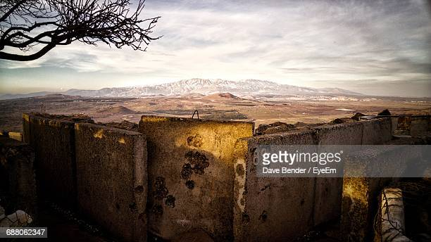 Scenic View Of Landscape And Mountains Against Cloudy Sky At Golan Heights